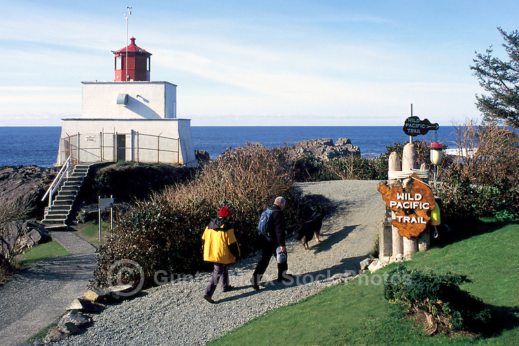 Amphitrite Point Lighthouse and Hikers on Wild Pacific Trail near Ucluelet, BC, on West Coast of Vancouver Island, British Columbia, Canada