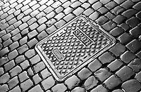 """Rone, Italy - Modern Manhole covers in Rome still bear the initals of the ancient Roman empire.  SPQR stood for the latin,  """"Sen?tus Populusque R?m?nus"""" or """"The Senate and the People of Rome"""""""