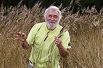 Botanist David Bellamy amongst the reeds on the Norfolk broads.