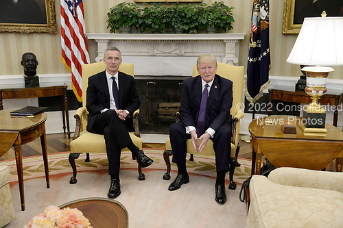 United States President Donald Trump meets with Secretary General Jens Stoltenberg of NATO.in the Oval Office of the White House in Washington, DC, April 12, 2017.<br /> Credit: Olivier Douliery / Pool via CNP