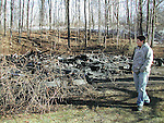 WASHINGTON, CT - 04 Jan. 2009 - 010409KM01 - Charles Moriniere, 15, looks at what is left of the house he lived in at 22 Wheaton Road in Washington on Sunday. Fire destroyed the 19th-century Victorian house late Saturday night. Kurt Moffett Republican-American
