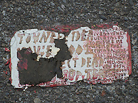 A Toynbee Tile is seen embedded into the pavement at a site in the Chelsea neighborhood of New York on Wednesday, September 24, 2014. Toynbee tiles are messages of unknown origin embedded in streets in about two dozen major cities in the United States and four South American capitals. Since the 1980s, several hundred tiles have been discovered. (© Richard B. Levine)