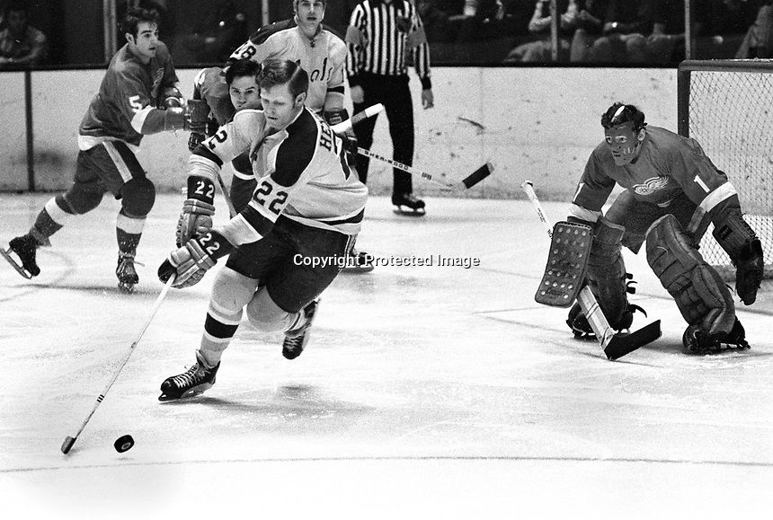 Seals Dennis Hextall ready to fire on RedWing goalie Jim Rutherford, #5 Serge Lajeunesse, and defenceman Arnie Brown..1971 photo/Ron Riesterer