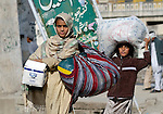 Following an October 8, 2005, earthquake, two survivors in the devastated town of Balakot.