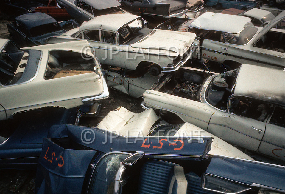New York, NY. 1970. A large amount of cars are abandoned in the street every year. New York City's sanitation department places them in junk yards.
