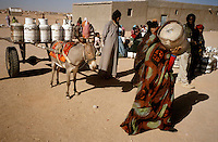 The Saharawi refugee camp  ..El Ayoun.Supply of gas tank.January 2008