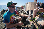 Festival goers smokes Hash oil to smoke at Hempfest 2014 on the Seattle on August 17, 2014.  Seattle Hempfest, celebrating its 23rd anniversary, features six stages of music, world renowned speakers, hundreds of food, arts, crafts and political booths.   © 2014. Jim Bryant Photo. All rights reserved.