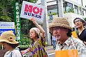 "Tokyo, Japan - June 17: In front of a sign, ""No Nuclear Power and Peace Are The Wish of Everyone,"" people marched against nuclear power plants in Japan at Mitaka, Tokyo, Japan on June 17, 2012. As Japanese Government decided to restart Oi Nuclear Power Plants No.3 and 4 in Fukui, people spoke up against the restart throughout the nation. ."