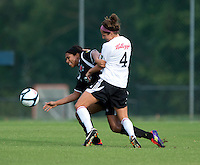 Victoria Johnson (26) of the Virginia Beach Piranhas fights for the ball with Emily Dale (4) of the Fredericksburg Impact during the game at the University of Mary Washington Battleground Stadium in Fredericksburg, VA.   The Virginia Beach Piranhas defeated the Fredericksburg Impact, 2-0, in a weather shortened game.