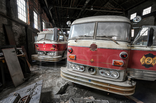 Large steel mills often had their own fire departments for safety reasons and these retired Mack fire trucks belonged to Bethlehem Steel at their main plant in Bethlehem PA. When this steel mill closed in 1995, the trucks were run into one of the giant buildings on the site along with other industrial leftovers and left there. I was fortunate to get special permission through a local historical group to go onto the property to shoot.<br /> <br /> There was a lot of disarray in that large building and the other junk included a small railroad locomotive, wooden sand molds, forklifts, large metal cabinets full of blueprints, various electrical apparatus, and even old metal hard hats. It was the rump left of what was once the second largest corporation in the world.<br /> <br /> The trucks are late fifties or early sixties Macks, which were probably made at the Mack plant that still exists in nearby Allentown. Today the property has been made into a vibrant music and arts center with the original blast furnaces standing as a backdrop. For more information, see http://www.steelstacks.org/