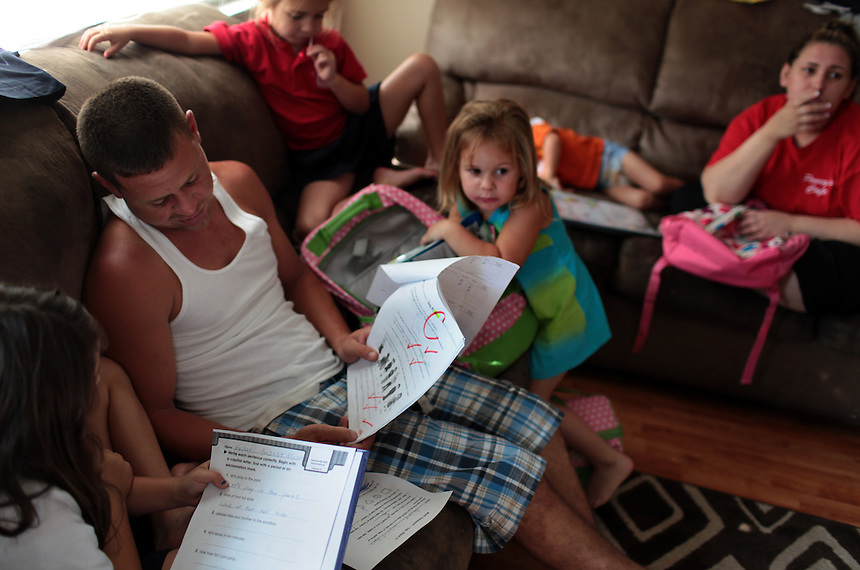 Jason Melerine with his family at his home in Poydras, LA on August 31, 2010.