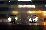 May 18, 2012; Topeka, KS, USA: NHRA top fuel dragster driver Shawn Langdon (left) races alongside Brandon Bernstein during qualifying for the Summer Nationals at Heartland Park Topeka. Mandatory Credit: Mark J. Rebilas-