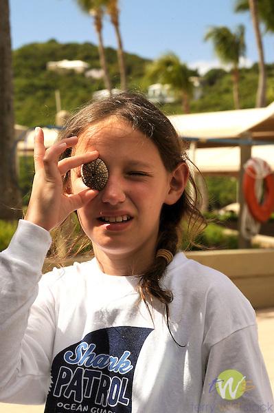 Westin Resort, St. John, USVI, Caribbean. Sophie looking through shell