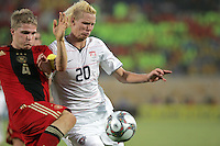The United States' Brek Shea (20) fights off Germany's Florian Jungwirth (4) during the FIFA Under 20 World Cup Group C Match between the United States and Germany at the Mubarak Stadium on September 26, 2009 in Suez, Egypt.   The US team lost to Germany 3-0.
