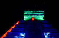 Pyramid in colorfull spotlight at night. Chichen Itza - from Yucatec Maya: Chi'ch'&egrave;en &Igrave;itsha &quot;at the mouth of the well of the Itza&quot;) is a large pre-Columbian archaeological site built by the Maya civilization located in the northern center of the Yucat&aacute;n Peninsula, in the Municipality of Tin&uacute;m, Yucat&aacute;n state, present-day Mexico...Chichen Itza was a major focal point in the northern Maya lowlands from the Late Classic through the Terminal Classic and into the early portion of the Early Postclassic period. The site exhibits a multitude of architectural styles, from what is called &quot;In the Mexican Origin&quot; and reminiscent of styles seen in central Mexico to the Puuc style found among the Puuc Maya of the northern lowlands. The presence of central Mexican styles was once thought to have been representative of direct migration or even conquest from central Mexico, but most contemporary interpretations view the presence of these non-Maya styles more as the result of cultural diffusion. foto, reise, photograph, image, images, photo,<br /> photos, photography, picture, pictures, urlaub, viaje, vacation, imagen, viagi, stock