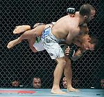 Darren Uyenoyama, white trunks, takes down Kid Yamamoto in a welterweight match during Saturday's UFC on Fox event at the Honda Center.