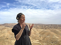 13. &quot;Settler&quot;: an impassioned woman tells us about Nofei Prat, a settlement in the Benjamin Regional Council, West Bank.<br /> <br /> In the West Bank, near Jerusalem in the Judean Desert, we visited the settlement &quot;Nofel Prat.&quot; The settlements are, of course, one of the most contentious and heatedly debated issues within and without Israel. Yet to be here, as a witness on the inside, the reality was more complex.<br />  <br /> We met with this woman and a Canadian medical student, equally impassioned and holding his baby son. They talked about their bonds with family and friends; the community, the beauty of the desert with a spring at the foot of the hills stretching below. Truly, the place seemed like an oasis. Was all this built on stolen land? Was it all a pack of lies? What to believe? It's not a simple story.