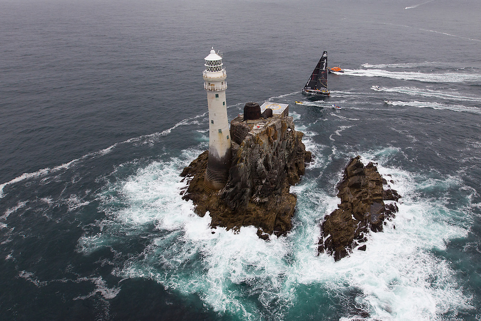 IRELAND, Fastnet Rock. 2nd July 2012. Volvo Ocean Race, Leg 9, Lorient to Galway. Abu Dhabi Ocean Racing rounds the Fastnet Rock.