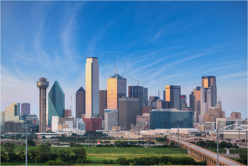 This Dallas skyline photograph looks east towards the downtown area. The sun was fading behind me, but the buildings were not yet lit up. My vantage point from the roof of a large housing development provided the perfect place to capture this cityscape.