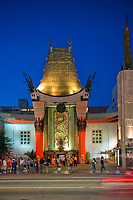 Grauman's Chinese Theater, Hollywood Ca. Boulevard, Night, Dusk, Royal Blue Sky,  Lights, reflections Vertical image