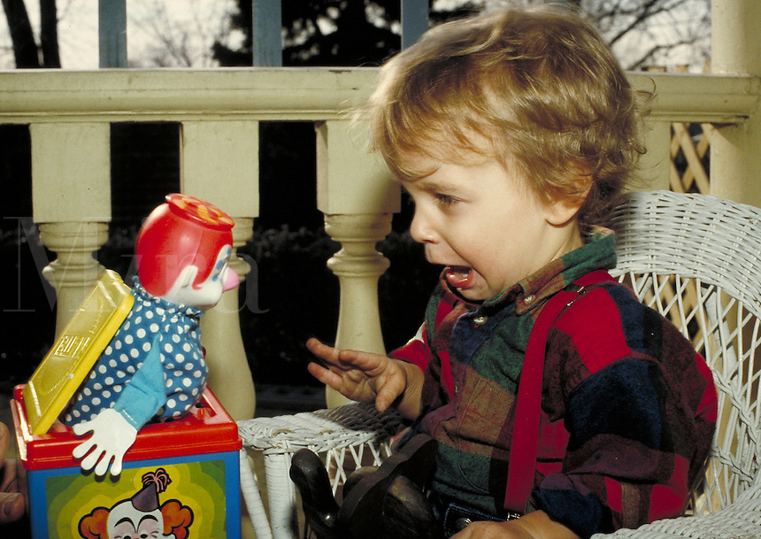 I see you! Little boy scared of Jack-in-the-box suddenly popping out. Little boy. Douglaston NY.