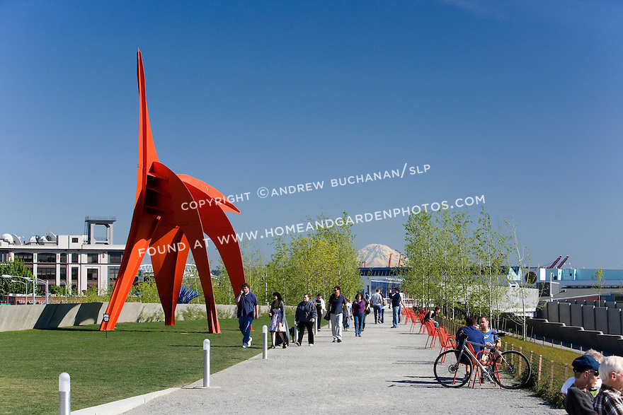 "The vivid red of Alexander Calder's, ""Eagle, 1971"" contrasts with the vivid blue of a Northwest sky and the white snow capping Mt. Rainier some 60 miles distant as it lines up along the walking path known as the Moseley Path.   SAM's Olympic Sculpture Park, Seattle, WA."