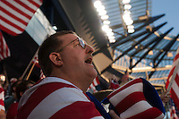A fan of the United States Men's National Team sings the national anthem before the United States played Guatemala at Livestrong Sporting Park in Kansas City, Kansas in a World Cup Qualifier on Tue. Oct. 16, 2012.