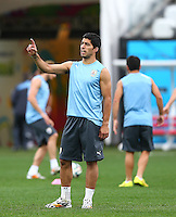 Luis Suarez of Uruguay points his finger as he trains in the Arena Corinthians, Sao Paulo ahead of his sides Group D crunch fixture vs England tomorrow