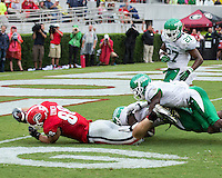 The Georgia Bulldogs played North Texas Mean Green at Sanford Stadium.  After North Texas tied the game at 21 early in the second half, the Georgia Bulldogs went on to score 24 unanswered points to win 45-21.  Georgia Bulldogs tight end Arthur Lynch (88) reaches for the goal line with North Texas Mean Green defensive back Hilbert Jackson (6), North Texas Mean Green linebacker Zach Orr (35) holding on.