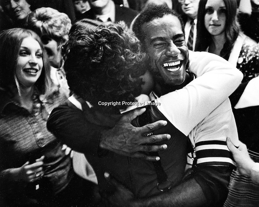 """Oakland Athletics Alan Lewis, nicknamed """"The Pamanamanmainan Express"""" pinch runner gets a hug from one of the players wives in the locker room in Cincinnati after the A's beat the Reds for the 1972 World Series. (photo/Ron Riesterer)"""