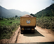 Trucks carrying bauxite and other materials are seen parked on the road leading to the Vedanta Alumina Company in Lanjigarh, Orissa. Seen at the distance are the Niyamgiri hills.
