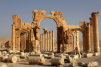 The Monumental Arch, built under the reign of Septimius Severus (193 - 211 AD), with the Great Colonnade in the distance, Palmyra, Syria Picture by Manuel Cohen