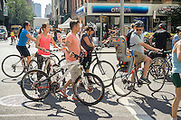 Bicycles and pedestrians take to the streets on Saturday, August 15, 2015, 2012 for the 8th annual New York Summer Streets event. 6.9 miles of Manhattan streets were cleared of traffic from 7 A.M. to 1 P.M., stretching from the Brooklyn Bridge to East 72nd street and thousands of people came out to walk, bike and involve themselves in the activities that were set up at the rest stops along the way. (© Richard B. Levine)