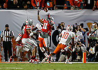 Ohio State Buckeyes defensive back Vonn Bell (11) catches an interception in the second quarter of the Discover Orange Bowl between Ohio State and Clemson at Sun Life Stadium in Miami Gardens, Florida, Friday night, January 3, 2014. As of half time the Ohio State Buckeyes led the Clemson Tigers 22 - 20.(The Columbus Dispatch / Eamon Queeney)