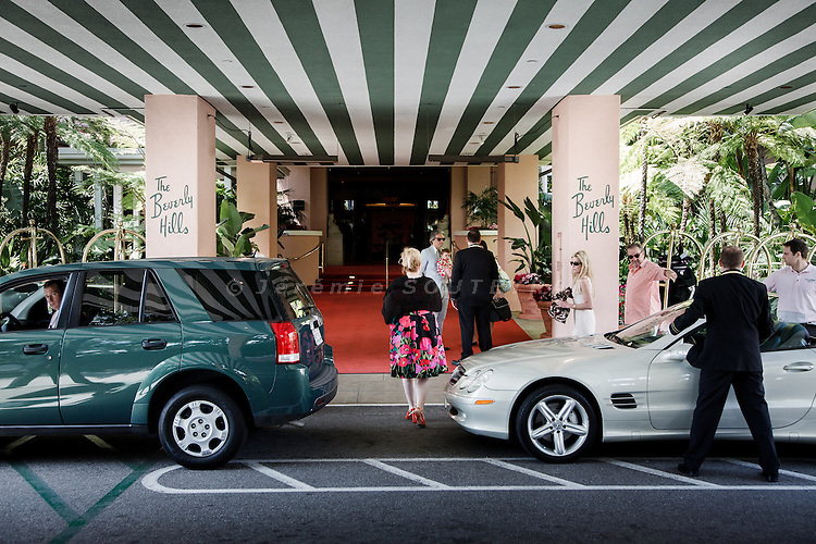 Los Angeles, April 9 2012- Groom service at the entrance of the Beverly Hills hotel.