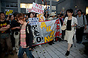June 22, 2012, Tokyo, Japan - Walkers stop to see the slogans of demonstrators during a demo to protest restarting Oi plant and curious walkers stop to see them. Anti-nuclear protesters stage a Twitter organized rally in front of the Prime Minister's Official Residence opposing the reactivation of the Oi Nuclear Power Plant in Fukui Prefecture. ..