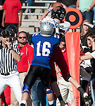 Friendswood reciever Jordan Bolton (16) turns defender as Lake Travis defensive back Bryan Kribbs(15) intercepts quarterback Pete Maetzold's pass.  Maetzold had 4 interceptions in the game. The Friendswood Mustangs lost to the Lake Travis Cavilers 24 - 3 at Kyle Field on December 11, 2010 in the Class 4A, D-1 state semifinals.