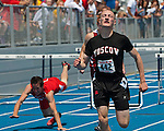 Moscow senior Wade Schumaker crosses the finish line during the Idaho High School 4A Track and Field Championships 110 meter hurdles competition on May 19, 2012 at Middleton High School, Middleton, Idaho. Schumaker finished first with a time of 14.56, a new  state meet 4A classification record.