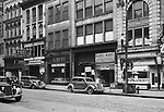 Pittsburgh PA: View of the stores on the 400 block of Wood Street - 1935.  Nearby stores include; Radio Mart, Kings Clothing, Klein's Shoes, John M Roberts and Sons and Dimlings Candy