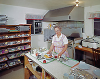 Jack Rees Nursing Home, Woman in an apron, fixing meals in the kitchen