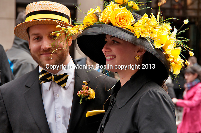 A couple wears black and yellow outfits and hats to the Easter Day Parade in New York City on Fifth Avenue