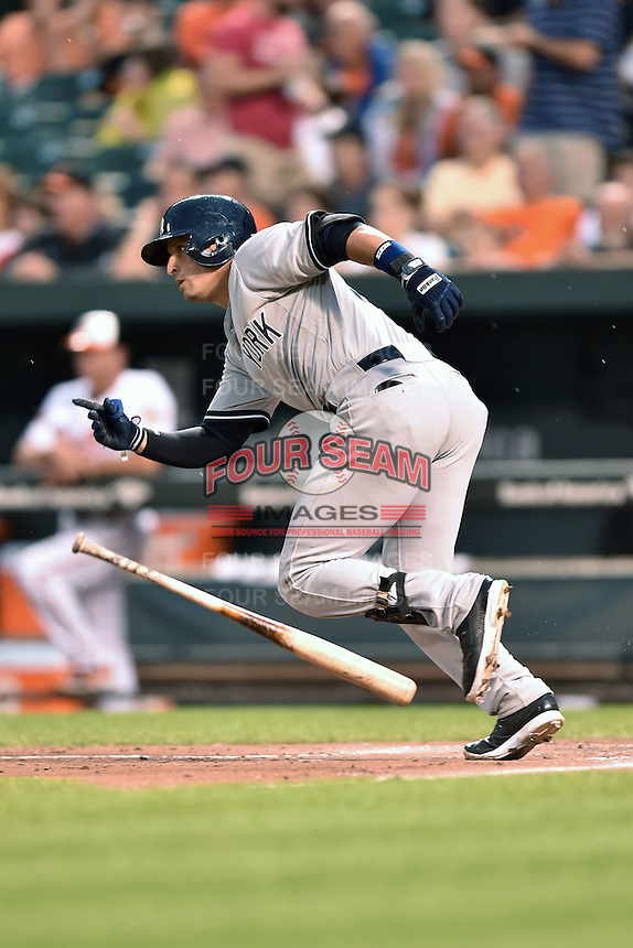 New York Yankees right fielder Martin Prado #14 swings at a pitch during a game against the Baltimore Orioles at Oriole Park at Camden Yards August 11, 2014 in Baltimore, Maryland. The Orioles defeated the Yankees 11-3. (Tony Farlow/Four Seam Images)
