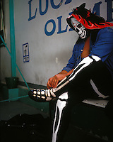La Parka changes into his get-up for a photo shoot, La Parka is one of Mexico's wrestling superstars. The original Parka had his identity stripped from him and passed on to a younger fighter by the Wrestling Association when he refused to sub,mit to the often unfair terms of his contract. The association is known for registering (with copyright) the names and identities of the Luchadores they promote.