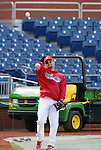 10/17/08 1:34:24 PM -- Philadelphia, PA, U.S.A. -- Philadelphia Phillies Shane Victorino warms up before practice October 17, 2008 at Citizen's Bank Park in Philadelphia, Pennsylvania. Victorino showed the team that cast him aside that it made a costly error. The Philadelphia outfielder, who spent six years in the L.A. Dodgers' farm system, used key hits in pressure situations, including a triple, Game 4 eighth-inning homer and six RBI during the NLCS, to help the Phillies beat the Dodgers and reach their first World Series since 1993. -- ...Photo by William Thomas Cain/cainimages.com.