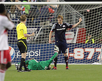 Both New England Revolution defender Pat Phelan (28), and New England Revolution goalkeeper Preston Burpo (24) request aid from the bench. Preston Burpo was removed from the field with a lower right leg fracture.  The New England Revolution defeated the New York Red Bulls, 3-2, at Gillette Stadium on May 29, 2010.