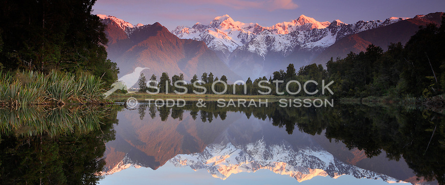 Iconic reflection of Mount Cook / Aoraki and Mount Tasman in Lake Matheson, Westland National Park, South Island, New Zealand