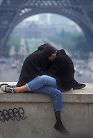 Young couple hugging at the Eiffel Tower - Photograph by Owen Franken