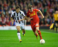 LIVERPOOL, ENGLAND - Thursday, October 4, 2012: Liverpool's Jack Robinson in action against Udinese Calcio's Marco Faraoni during the UEFA Europa League Group A match at Anfield. (Pic by David Rawcliffe/Propaganda)