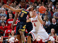 Ohio State Buckeyes guard Aaron Craft (4) fouls Maryland Terrapins guard Varun Ram (11) in the second half of the college basketball game between the Ohio State Buckeyes and the Maryland Terrapins at the Jerome Schottenstein Center in Columbus, Wednesday evening, December 4, 2013. The Ohio State Buckeyes defeated the Maryland Terrapins 76 - 60. (The Columbus Dispatch / Eamon Queeney)