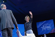 National Harbor, MD - February 24, 2017: Former republican presidential candidate Carly Fiorina wavs to the audience after participating in a conversation with Arthur Brooks of the American Enterprise Institute during the Conservative Political Action Conference at the Gaylord National Hotel in National Harbor, MD, February 24, 2017.  (Photo by Don Baxter/Media Images International)